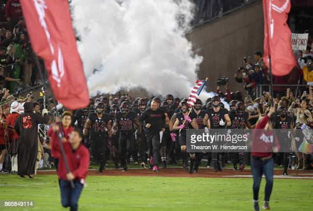 Head coach David Shaw of the Stanford Cardinal leads his team onto the field prior to playing the Oregon Ducks in an NCAA football game at Stanford...