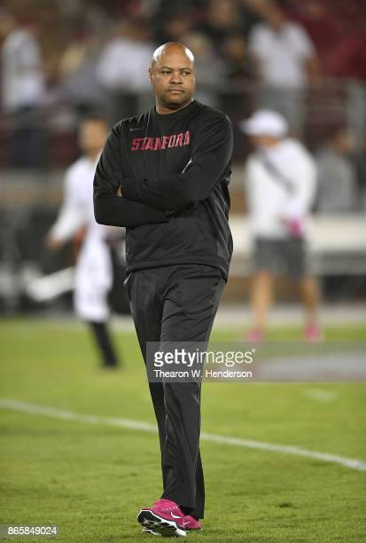 Head coach David Shaw of the Stanford Cardinal looks on while his team warms up during pregame warm ups prior to playing the Oregon Ducks at Stanford...