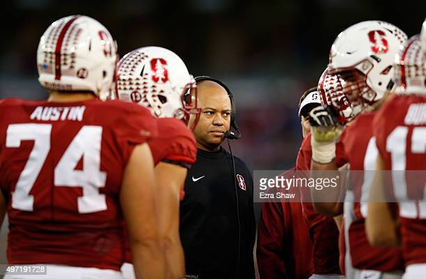 Head coach David Shaw of the Stanford Cardinal stands his team during a timeout in their game against the Oregon Ducks at Stanford Stadium on...
