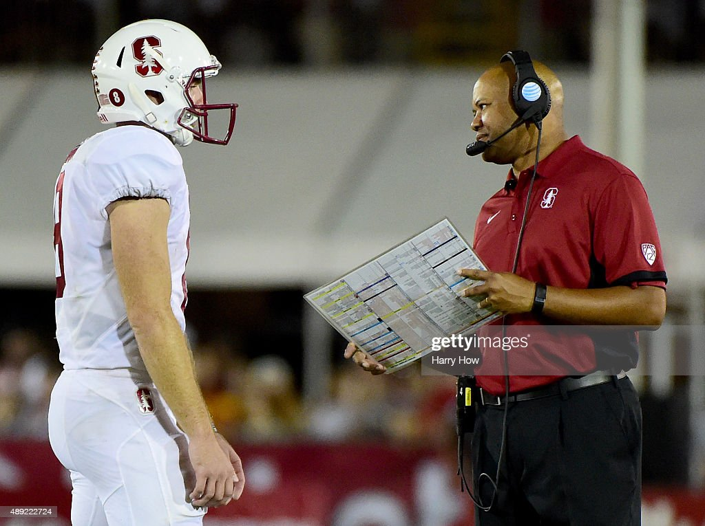Head coach David Shaw of the Stanford Cardinal talks to Kevin Hogan during a 4131 win over the USC Trojans at Los Angeles Coliseum on September 19...