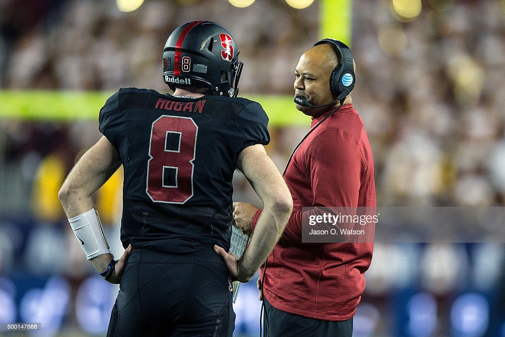 Head coach David Shaw of the Stanford Cardinal talks to quarterback Kevin Hogan during the first quarter of the Pac12 Championship game against the...