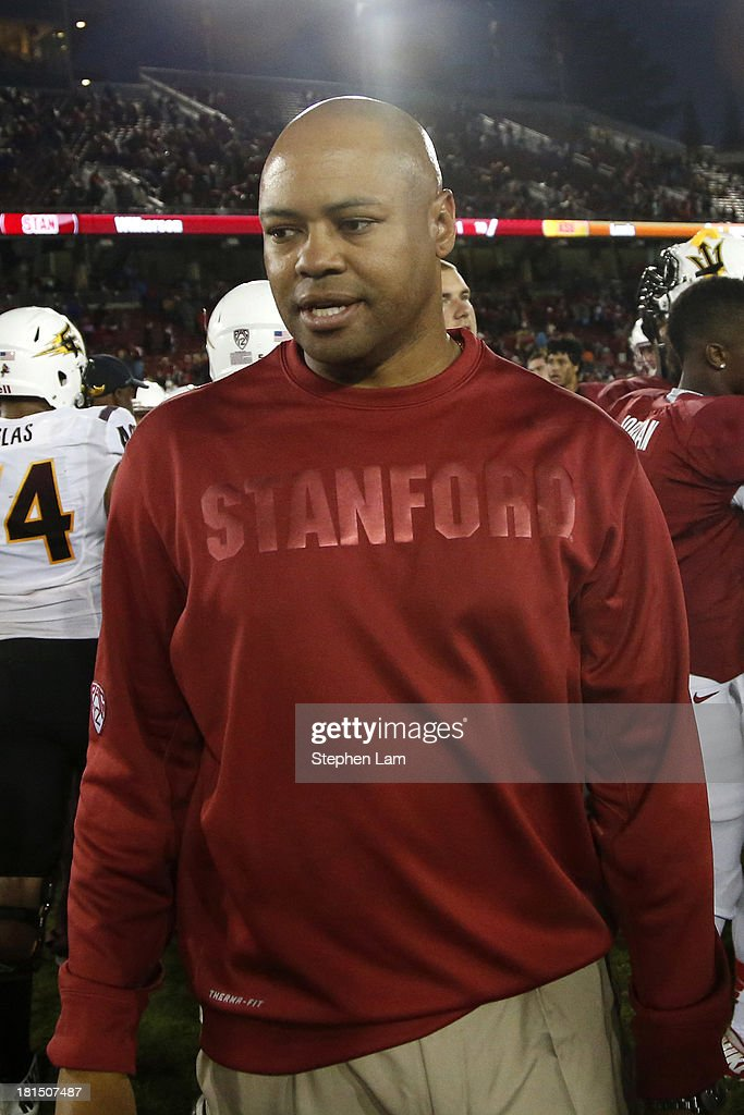 Head coach David Shaw of the Stanford Cardinal walks on the field after defeated the Arizona State Sun Devils 42-28 at Stanford Stadium on September 21, 2013 in Stanford, California.