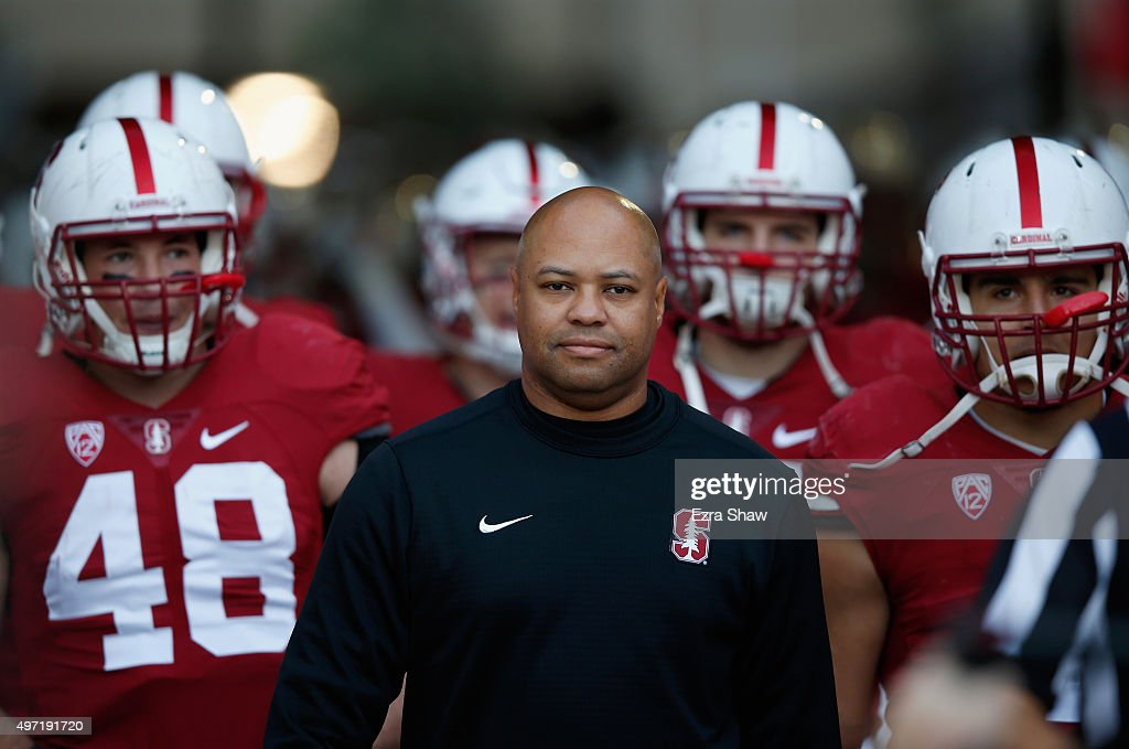 Head coach David Shaw of the Stanford Cardinal walks out to the field with his team before their game against the Oregon Ducks at Stanford Stadium on...