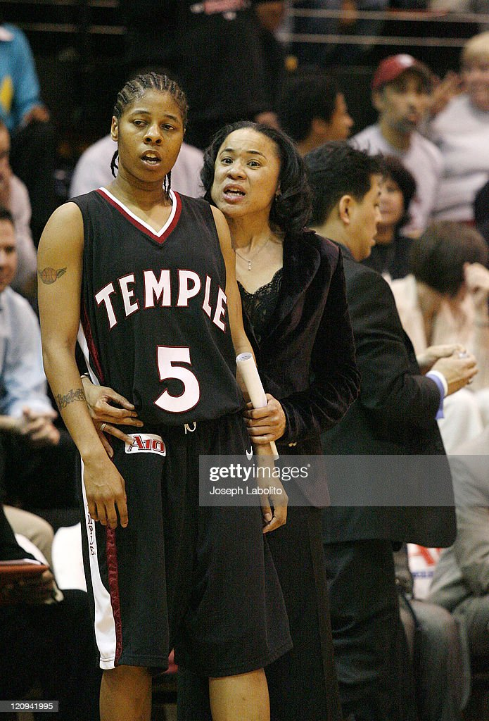 Head coach <a gi-track='captionPersonalityLinkClicked' href=/galleries/search?phrase=Dawn+Staley&family=editorial&specificpeople=209196 ng-click='$event.stopPropagation()'>Dawn Staley</a> cuts down the nets on her third consecutive A-10 title. The Temple Lady Owls defeated the George Washington Colonials 59 to 54 to capture their third straight A-10 title on at the SJU Fieldhouse in Philadelphia.