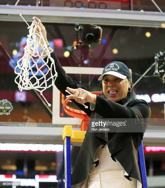 Head coach Dawn Staley of the South Carolina Gamecocks cuts down the net after her teams championship win over the Mississippi State Lady Bulldogs...