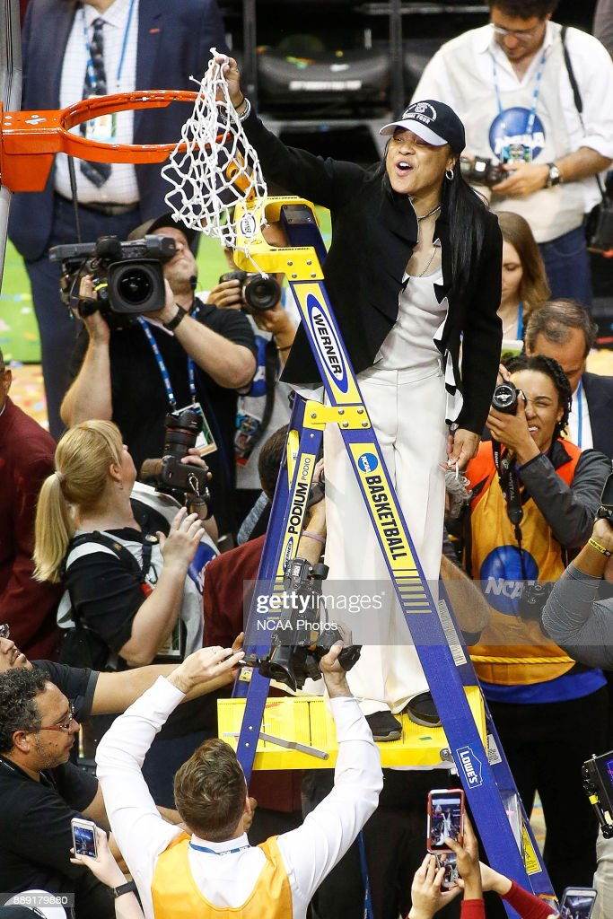 Head coach Dawn Staley of the South Carolina Gamecocks cuts down the net after her teams championship win over the Mississippi State Lady Bulldogs after the championship game of the 2017 NCAA Women's Final Four at American Airlines Center on April 2, 2017 in Dallas, Texas.