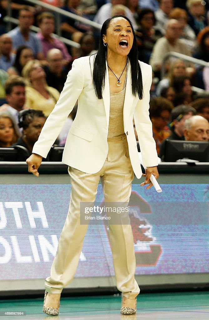 Head coach <a gi-track='captionPersonalityLinkClicked' href=/galleries/search?phrase=Dawn+Staley&family=editorial&specificpeople=209196 ng-click='$event.stopPropagation()'>Dawn Staley</a> of the South Carolina Gamecocks reacts in the first half against the Notre Dame Fighting Irish during the NCAA Women's Final Four Semifinal at Amalie Arena on April 5, 2015 in Tampa, Florida.