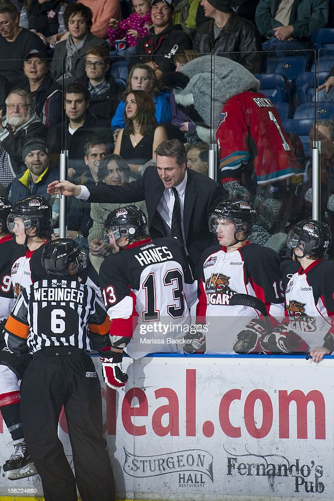 Head coach Dean Clark of the Prince George Cougars argues with a referee against the Kelowna Rockets on December 8, 2012 at Prospera Place in Kelowna, British Columbia, Canada.