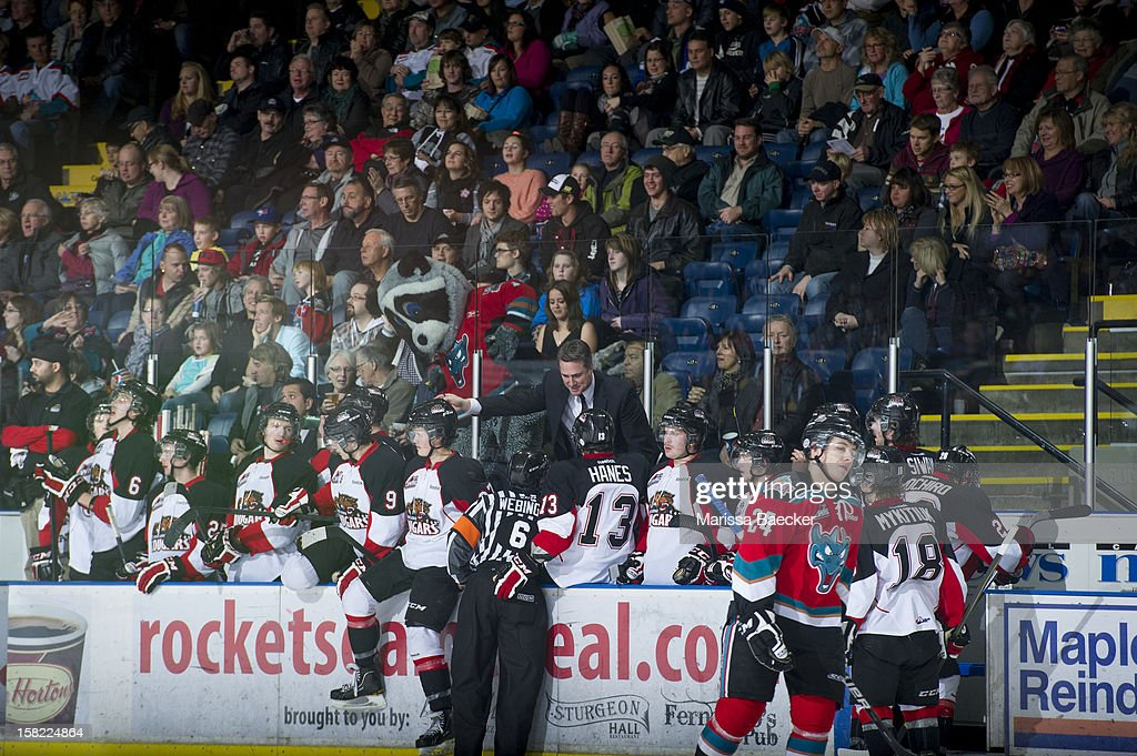 Head coach Dean Clark of the Prince George Cougars argues with a referee from the visitors bench against the Kelowna Rockets on December 8, 2012 at Prospera Place in Kelowna, British Columbia, Canada.