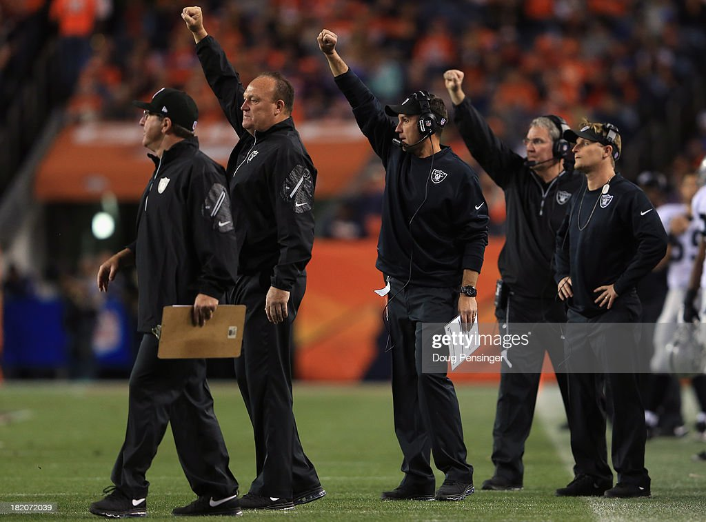 Head coach Dennis Allen (center) of the Oakland Raiders and his coaching staff lead the Raiders against the Denver Broncos at Sports Authority Field at Mile High on September 23, 2013 in Denver, Colorado. The Broncos defeated the Raiders 37-21.