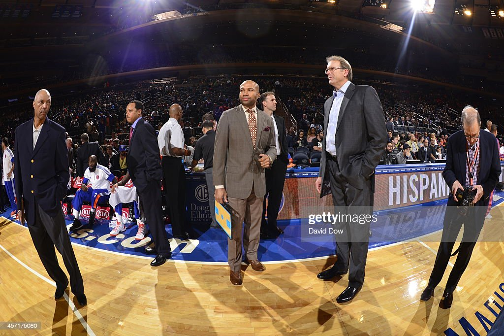Head coach Derek Fisher and associate head coach Kurt Rambis of the New York Knicks look on before a game against the Toronto Raptors at Madison...