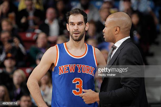 Head Coach Derek Fisher of the New York Knicks coaches Jose Calderon against the Sacramento Kings on December 27 2014 at Sleep Train Arena in...
