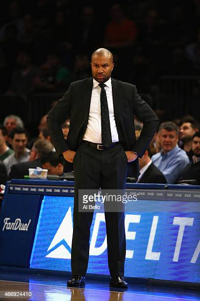 Head Coach Derek Fisher of the New York Knicks looks on against the San Antonio Spurs during their game at Madison Square Garden on March 17 2015 in...