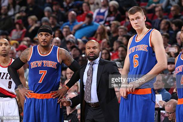 Head Coach Derek Fisher of the New York Knicks looks on with Carmelo Anthony and Kristaps Porzingis during the game against the Portland Trail...