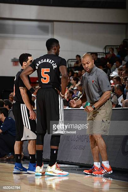 Head coach Derek Fisher of the New York Knicks speaks with Shane Larkin and Tim Hardaway Jr #5 against the Dallas Mavericks at the Samsung NBA Summer...