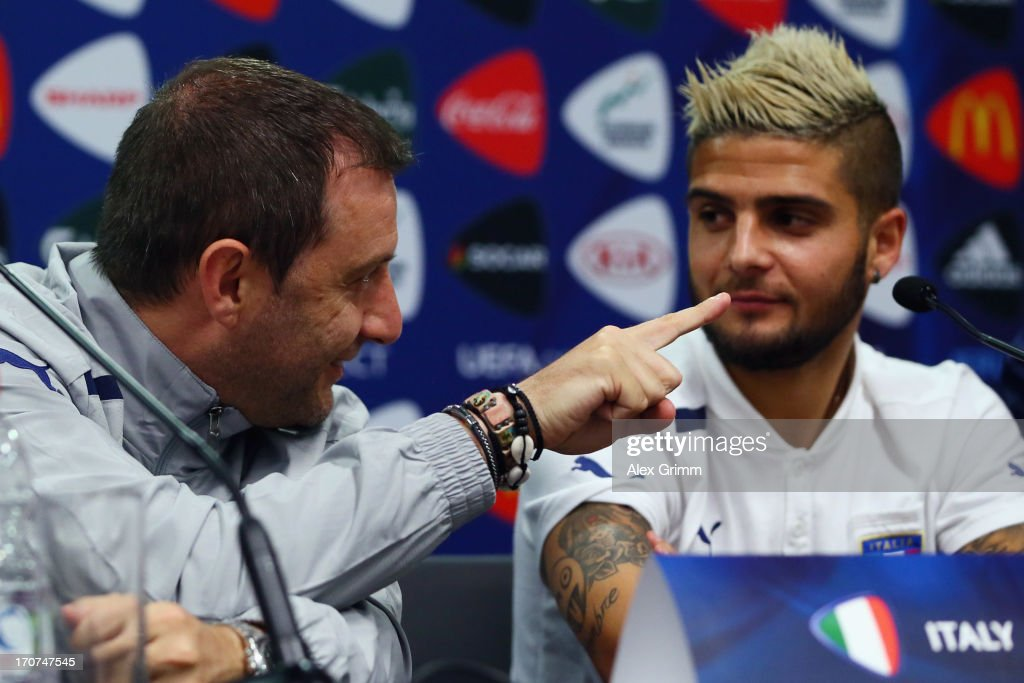 Head coach Devis Mangia (L) and <a gi-track='captionPersonalityLinkClicked' href=/galleries/search?phrase=Lorenzo+Insigne&family=editorial&specificpeople=7486481 ng-click='$event.stopPropagation()'>Lorenzo Insigne</a> of Italy attend an Italy U21 press conference at Teddy Stadium ahead of their UEFA European U21 Championship final match against Spain on June 17, 2013 in Jerusalem, Israel.