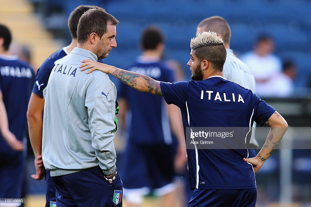 Head coach Devis Mangia and <a gi-track='captionPersonalityLinkClicked' href=/galleries/search?phrase=Lorenzo+Insigne&family=editorial&specificpeople=7486481 ng-click='$event.stopPropagation()'>Lorenzo Insigne</a> stand together during an Italy U21 training session at Teddy Stadium ahead of their UEFA European U21 Championship final match against Spain on June 17, 2013 in Jerusalem, Israel.