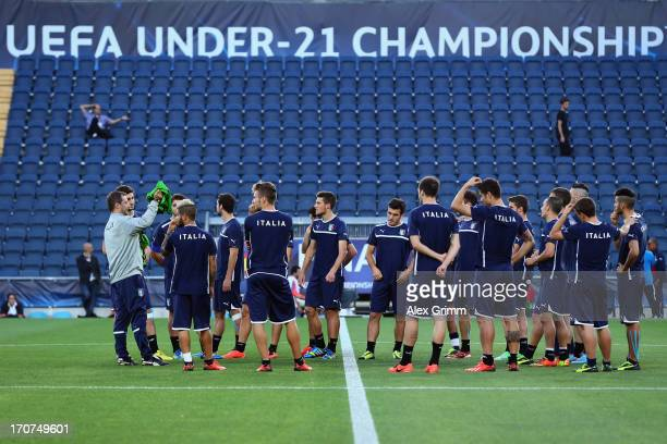Head coach Devis Mangia hands out the bibs to his players during an Italy U21 training session at Teddy Stadium ahead of their UEFA European U21...