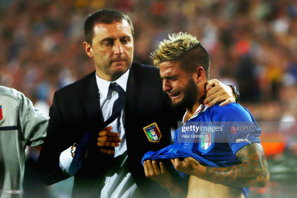 Head coach Devis Mangia of Italy comforts <a gi-track='captionPersonalityLinkClicked' href=/galleries/search?phrase=Lorenzo+Insigne&family=editorial&specificpeople=7486481 ng-click='$event.stopPropagation()'>Lorenzo Insigne</a> after losing their UEFA European U21 Championship final match against Spain at Teddy Stadium on June 18, 2013 in Jerusalem, Israel.