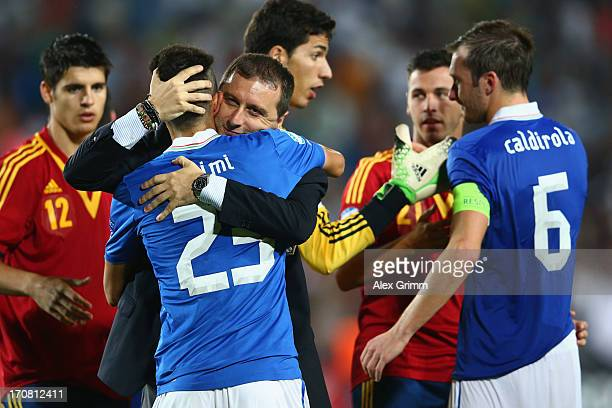 Head coach Devis Mangia of Italy comforts Marco Crimi and Luca Caldirola after losing their UEFA European U21 Championship final match against Spain...