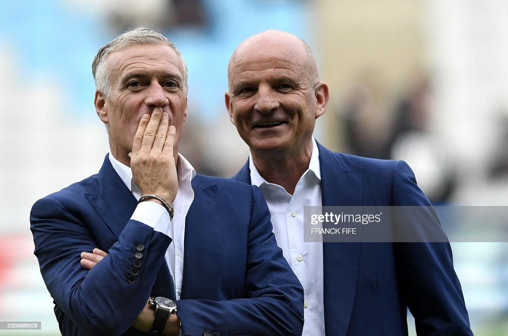Head coach Didier Deschamps and his assistant Guy Stephan look on prior to the friendly football match between France and Cameroon, at the Beaujoire Stadium in Nantes, western France, on May 30, 2016. / AFP / FRANCK
