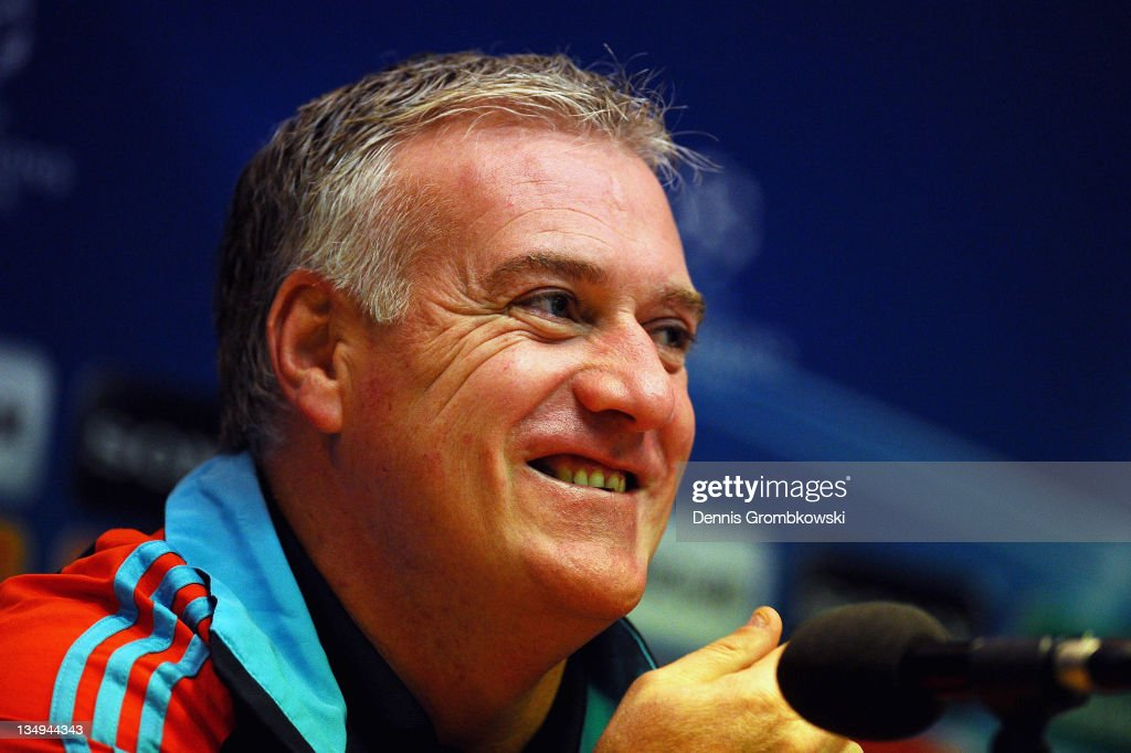 Head coach <a gi-track='captionPersonalityLinkClicked' href=/galleries/search?phrase=Didier+Deschamps&family=editorial&specificpeople=213607 ng-click='$event.stopPropagation()'>Didier Deschamps</a> of Marseille smiles during a press conference ahead of their UEFA Champions League group F match against Borussia Dortmund at Signal Iduna Park on December 5, 2011 in Dortmund, Germany.