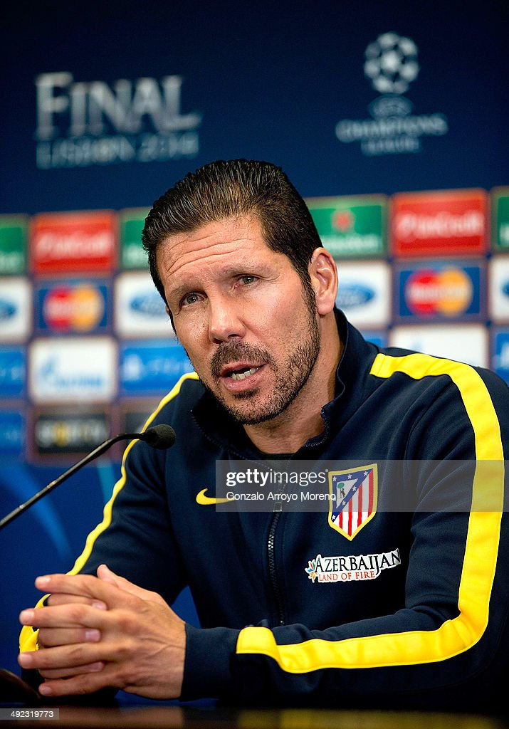 Head coach Diego Pablo Simeone of Atletico de Madrid answers questions from the media at a Club Atletico de Madrid press conference during the Media Day prior to UEFA Champions League Final between Club Atletico de Madrid and Real Madrid CF, at Vicente Calderon stadium on May 19, 2014 in Madrid, Spain.