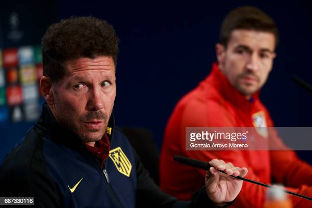 Head coach Diego Pablo Simeone of Atletico de Madrid attends a press conference with his player Gabi Fernandez ahead of the UEFA Champions League...
