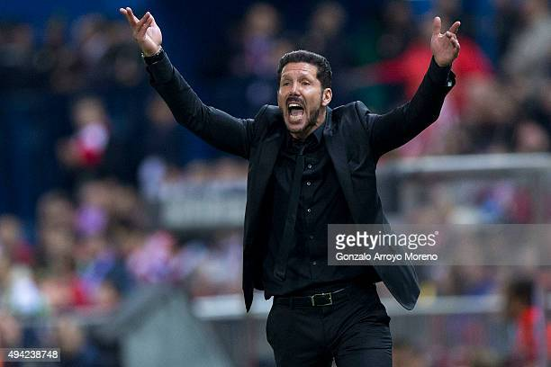 Head coach Diego Pablo Simeone of Atletico de Madrid encourages the audience during the La Liga amtch between Club Atletico de Madrid and Valencia CF...