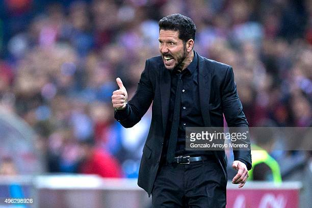 Head coach Diego Pablo Simeone of Atletico de Madrid gives instructions during the La Liga mathc bewteen Club Atletico de Madrid and Real Sporting de...