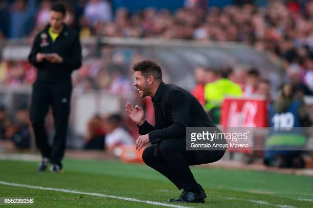 Head coach Diego Pablo Simeone of Atletico de Madrid gives instructions during the La Liga match between Club Atletico de Madrid and Sevilla FC at...