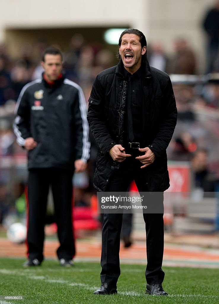 Head coach Diego Pablo Simeone of Atletico de Madrid gives instructions to hos players during the La Liga match between Club Atletico de Madrid and Real Valladolid CF at Vicente Calderon Stadium on February 15, 2014 in Madrid, Spain.