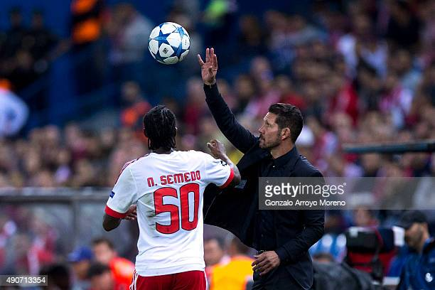 Head coach Diego Pablo Simeone of Atletico de Madrid holds the ball behind Nelson Semedo of SL Benfica during the UEFA Champions League Group C match...
