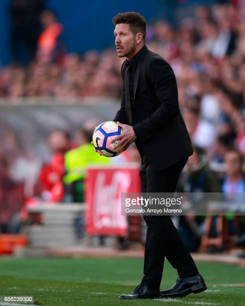Head coach Diego Pablo Simeone of Atletico de Madrid holds the ball during the La Liga match between Club Atletico de Madrid and Sevilla FC at...