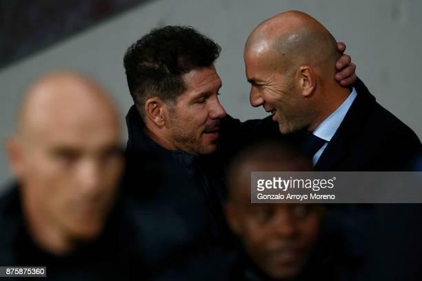 Head coach Diego Pablo Simeone of Atletico de Madrid hugs head coach Zinedine Zidane of Real Madrid CF prior to start the La Liga match between Club...