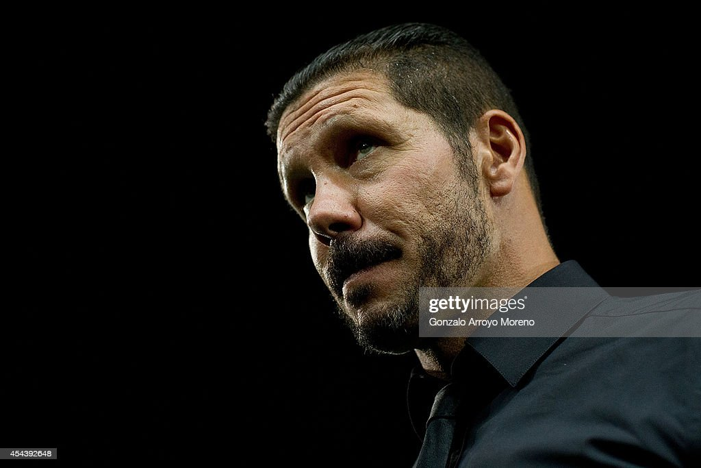 Head coach Diego Pablo Simeone of Atletico de Madrid leaves the pitch after the La Liga cup celebration held after the La Liga match between Club Atletico de Madrid and SD Eibar at Vicente Calderon Stadium on August 30, 2014 in Madrid, Spain.
