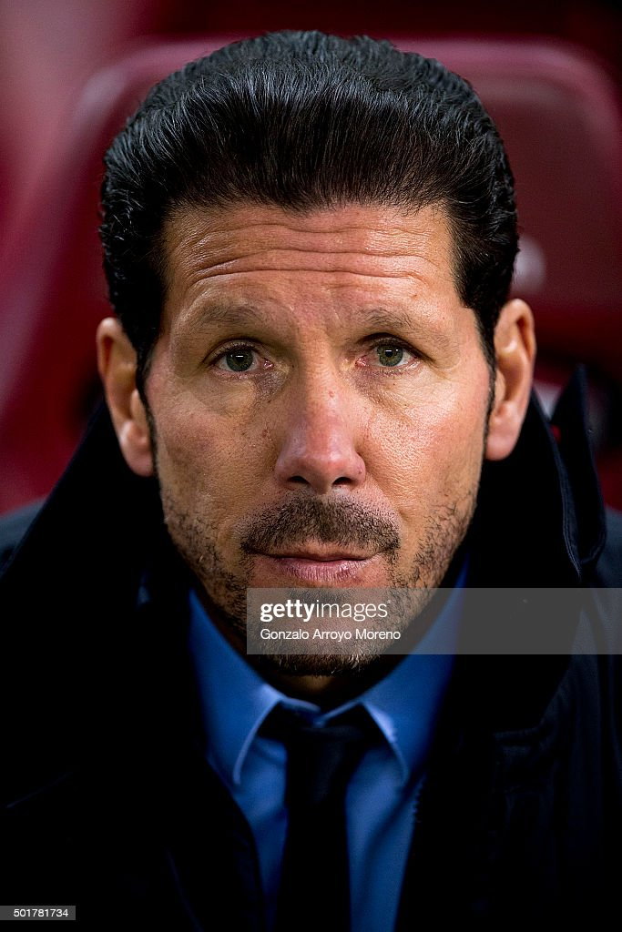 Head coach Diego Pablo Simeone of Atletico de Madrid looks on sitted on the bench prior to start the Copa del Rey Round of 32 match between Club Atletico Madrid and CF Reus Deportiu at Vicente Claderon stadium on December 17, 2015 in Madrid, Spain.