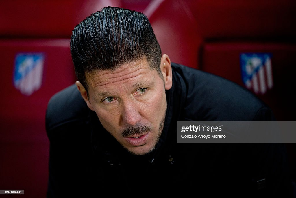 Head coach Diego Pablo Simeone of Atletico de Madrid sits on the bench prior to start the La Liga match between Club Atletico de Madrid and Villarreal CF at Vicente Calderon Stadium on December 14, 2014 in Madrid, Spain.