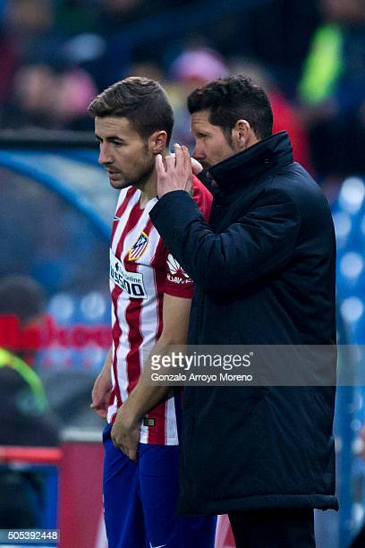 Head coach Diego Pablo Simeone of Atletico de Madrid speaks with his player Gabi Fernandez during the Copa del Rey Round of 16 second leg match...