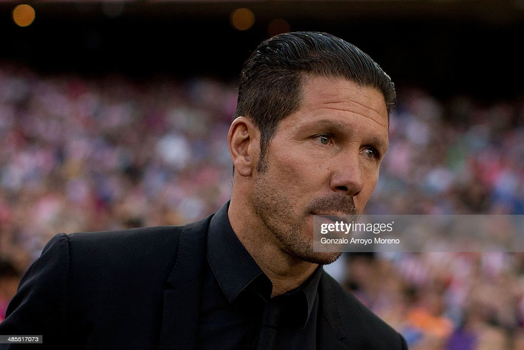 Head coach Diego Pablo Simeone of Atletico de Madrid walks to the bench prior to start the La Liga match between Club Atletico de Madrid and Elche FC at Vicente Calderon Stadium on April 18, 2014 in Madrid, Spain.