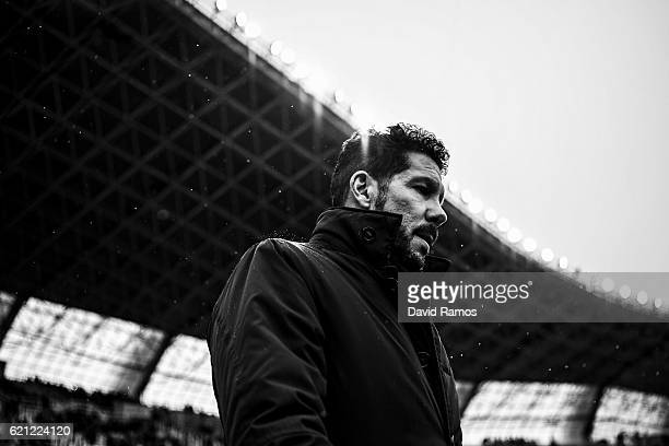 Head coach Diego Pablo Simeone of Atletico Madrid looks on during the La Liga match between Real Sociedad de Futbol and Atletico de Madrid at Anoeta...