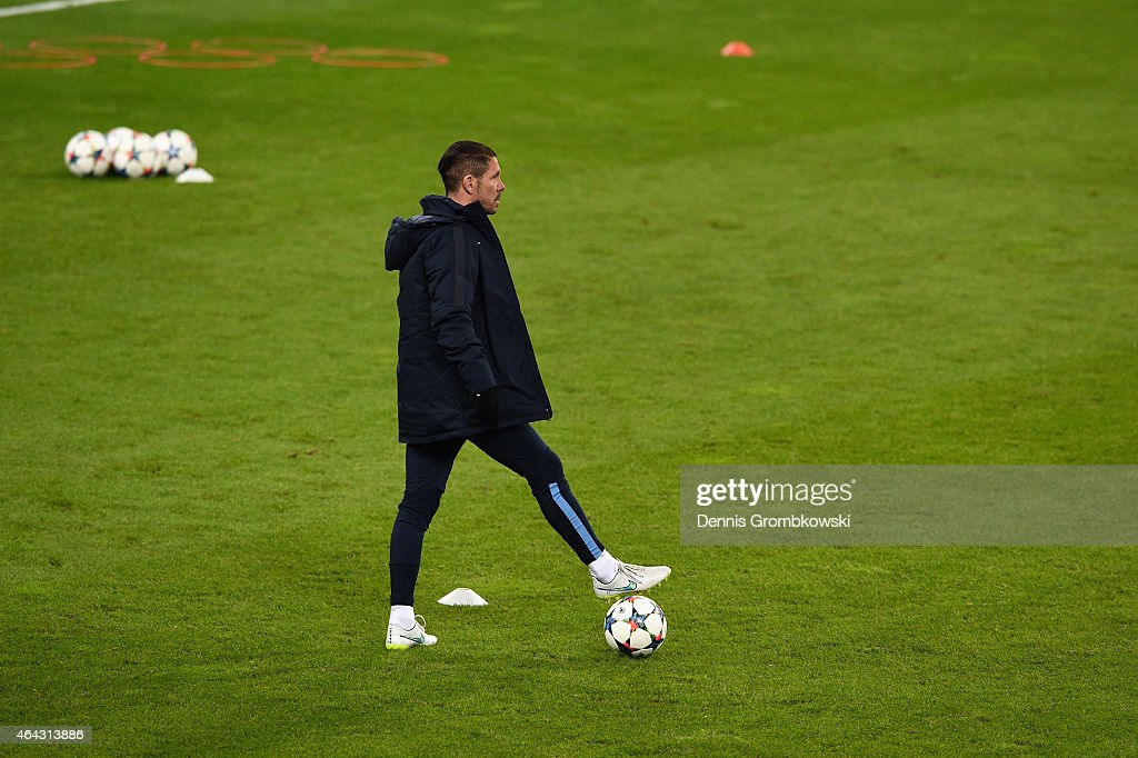 Head coach Diego Pablo Simeone of Atletico Madrid reacts during a training session ahead of their UEFA Champions League Round of 16 first leg match against Bayer Leverkusen on February 24, 2015 in Leverkusen, Germany.