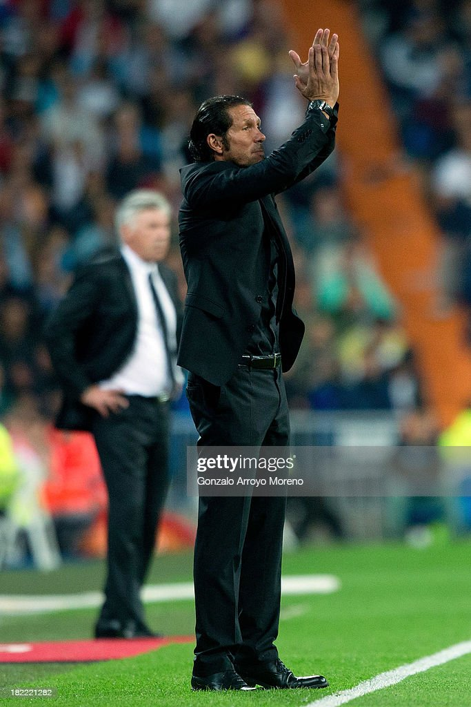 Head coach <a gi-track='captionPersonalityLinkClicked' href=/galleries/search?phrase=Diego+Simeone&family=editorial&specificpeople=226872 ng-click='$event.stopPropagation()'>Diego Simeone</a> of Atletico de Madrid congratulates their players during the La Liga match between Real Madrid CF and Club Atletico de Madrid at Estadio Santiago Bernabeu on September 28, 2013 in Madrid, Spain.