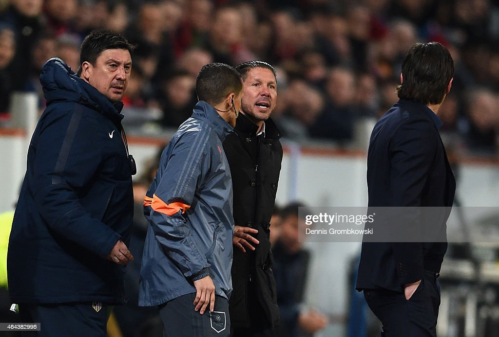 Head Coach <a gi-track='captionPersonalityLinkClicked' href=/galleries/search?phrase=Diego+Simeone&family=editorial&specificpeople=226872 ng-click='$event.stopPropagation()'>Diego Simeone</a> of Atletico Madrid and his backroom staff argue with <a gi-track='captionPersonalityLinkClicked' href=/galleries/search?phrase=Roger+Schmidt+-+Soccer+Manager&family=editorial&specificpeople=13515848 ng-click='$event.stopPropagation()'>Roger Schmidt</a> coach of Bayer Leverkusen during the UEFA Champions League round of 16 match between Bayer 04 Leverkusen and Club Atletico de Madrid at BayArena on February 25, 2015 in Leverkusen, Germany.