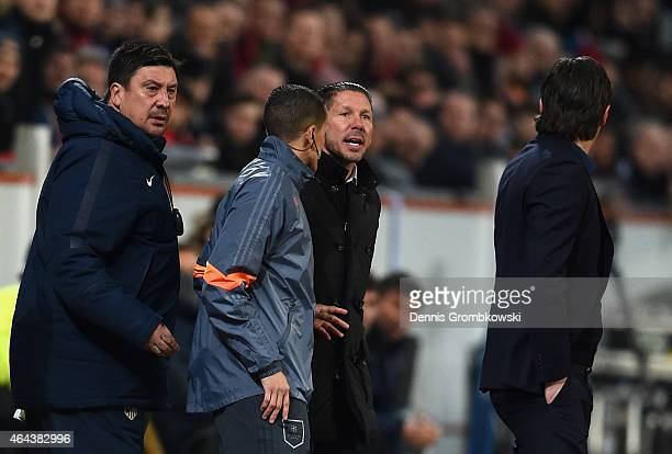 Head Coach Diego Simeone of Atletico Madrid and his backroom staff argue with Roger Schmidt coach of Bayer Leverkusen during the UEFA Champions...
