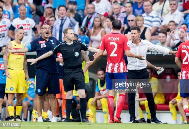 Head coach Diego Simeone of Atletico Madrid reacts with Diego Godin of Atletico Madrid after Godín receives a red card during the Audi Cup 2017 match...