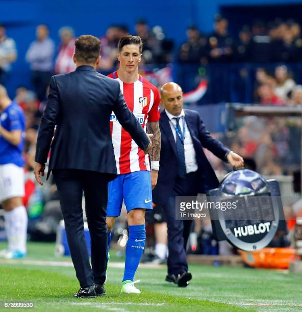 Head coach Diego Simeone of Atletico Madrid shakes hands with Fernando Torres of Atletico Madrid during the UEFA Champions League Quarter Final first...