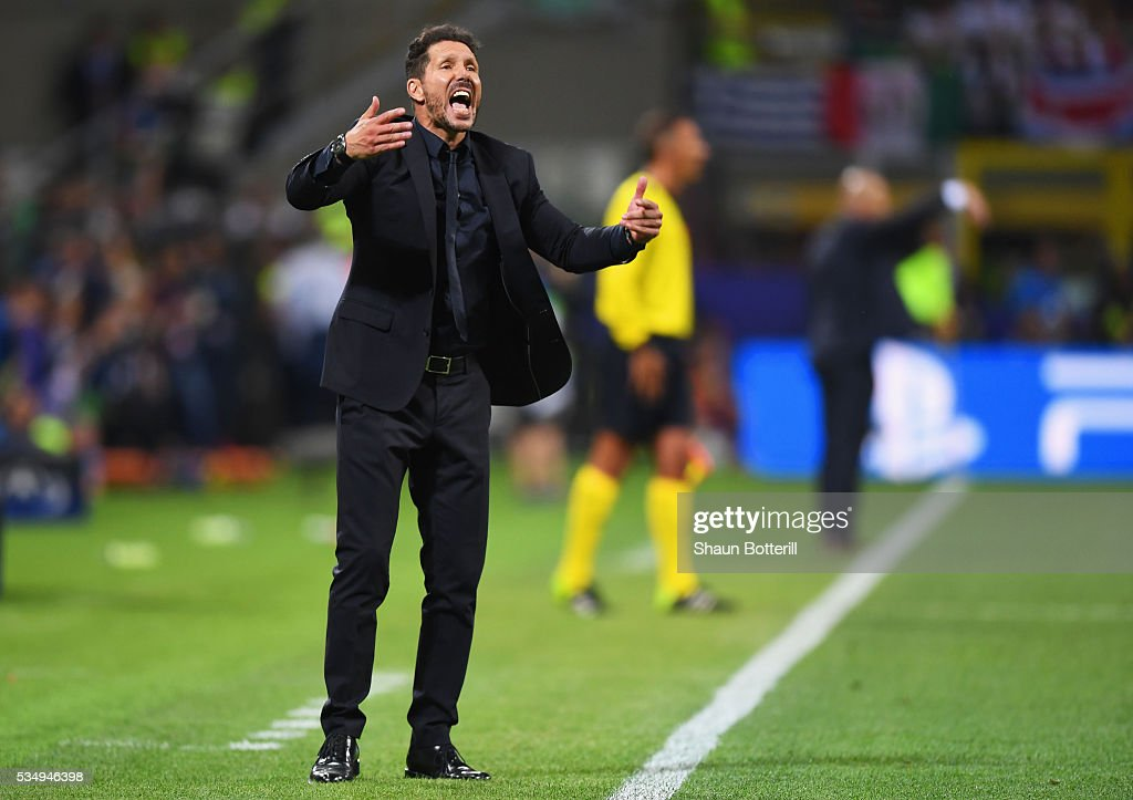 Head coach <a gi-track='captionPersonalityLinkClicked' href=/galleries/search?phrase=Diego+Simeone&family=editorial&specificpeople=226872 ng-click='$event.stopPropagation()'>Diego Simeone</a> of Atletico Madrid urges on his side during the UEFA Champions League Final match between Real Madrid and Club Atletico de Madrid at Stadio Giuseppe Meazza on May 28, 2016 in Milan, Italy.