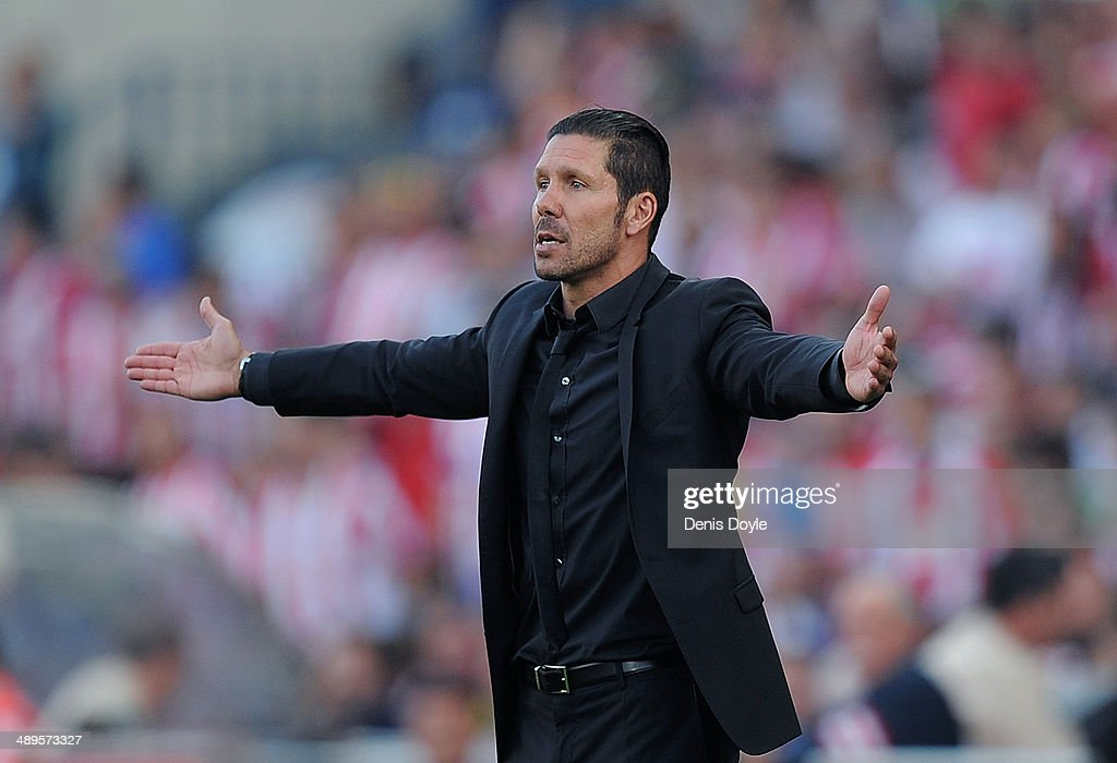 Head coach Diego Simeone of Club Atletico de Madrid reacts during the La Liga match between Club Atletico de Madrid and Malaga CF at Vicente Calderon Stadium on May 11, 2014 in Madrid, Spain.