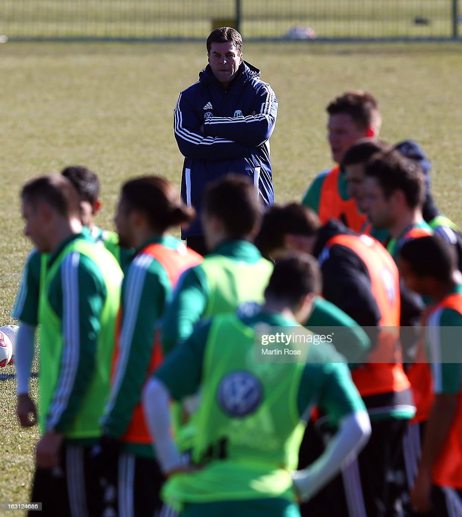 Head coach Dieter Heckimg (back) looks on during a VfL Wolfsburg training session on March 5, 2013 in Wolfsburg, Germany.
